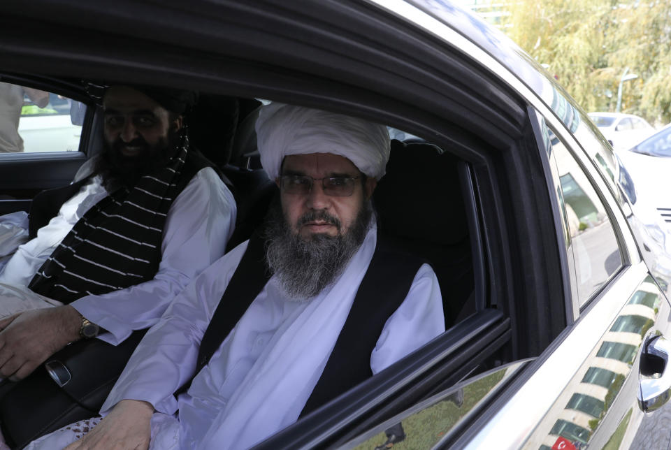 The Taliban delegation led by Amir Khan Muttaqi, the acting foreign minister, rear, sit in a car at Esenboga Airport, in Ankara, Turkey, Thursday, Oct. 14, 2021. A high-level delegation of Afghanistan's new Taliban rulers has arrived in Turkey for talks with Turkish officials, the Foreign Ministry announced Thursday. The meetings in the capital of Ankara would be first between the Taliban and senior Turkish government officials after the group seized control of Afghanistan. (AP Photo/Burhan Ozbilici)