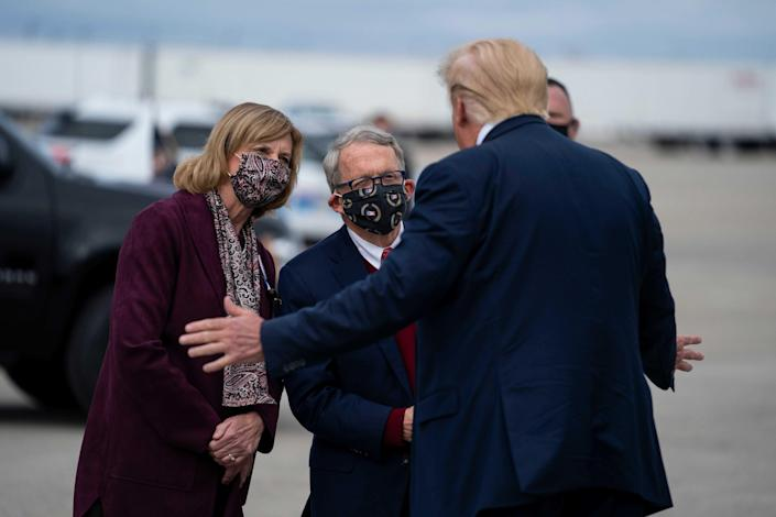 President Donald Trump talks to Ohio Gov. Mike and First Lady Fran DeWine after Trump arrived at Rickenbacker International Airport on Oct. 24 in Columbus prior to a rally in Circleville. The DeWines did not attend the rally. Trump appeared to hint at a primary challenge for DeWine in a Tweet on Monday morning.