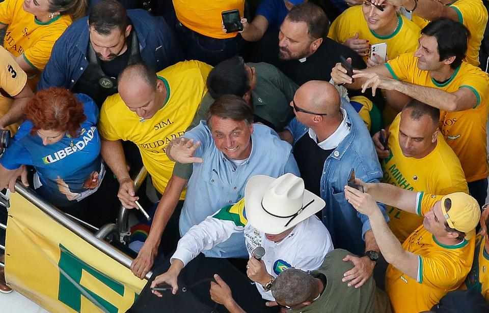Brazilian President Jair Bolsonaro waves as he joins thousands of fans marching to show their support, in Sao Paulo, on September 7, 2021, on Brazil's Independence Day. - Fighting record-low poll numbers, a weakening economy and a judiciary he says is stacked against him, President Jair Bolsonaro has called huge rallies for Brazilian independence day Tuesday, seeking to fire up his far-right base. (Photo by Miguel SCHINCARIOL / AFP) (Photo by MIGUEL SCHINCARIOL/AFP via Getty Images)