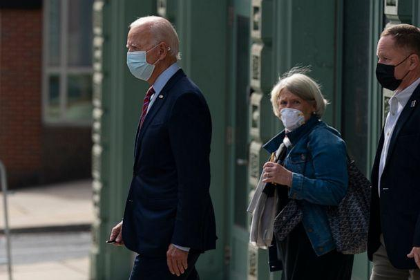 PHOTO: Democratic presidential candidate former Vice President Joe Biden and Anita Dunn center, depart The Queen theatre in Wilmington, Del., Monday, Oct. 19, 2020. (Carolyn Kaster/AP, File)