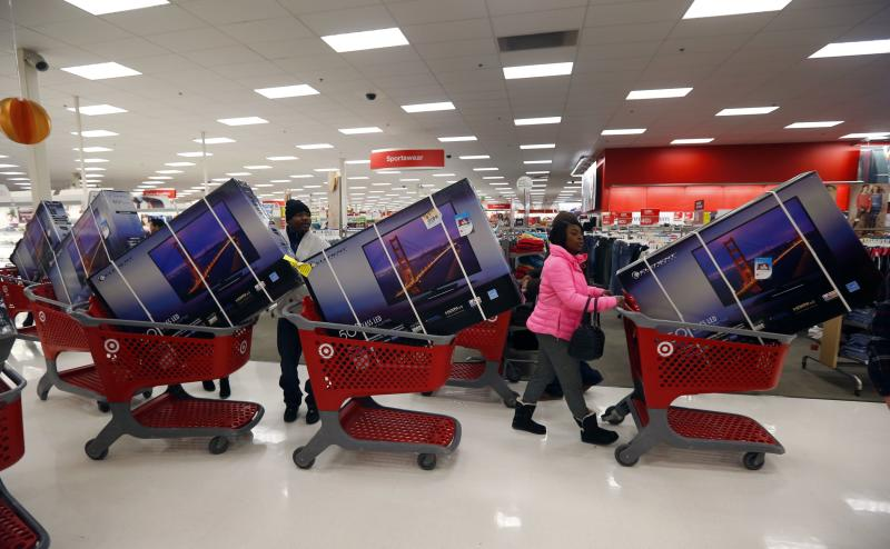 File photo of Thanksgiving Day holiday shoppers lining up with television sets on discount at the Target retail store in Chicago