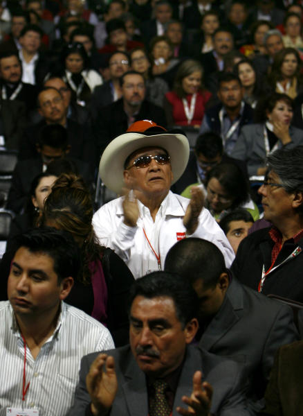 People attend a national convention of the Institutional Revolutionary Party (PRI), in Mexico City, Sunday, March 3, 2013. Mexico's ruling party changed on Sunday its platform to allow a reform that could bring private investment into the state-owned oil monopoly, in a country where oil is a source of national pride. (AP Photo/Marco Ugarte)