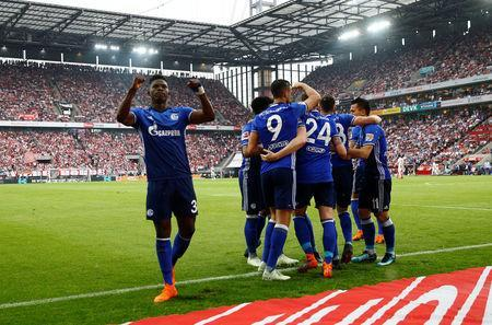 Soccer Football - Bundesliga - FC Cologne v Schalke 04 - RheinEnergieStadion, Cologne, Germany - April 22, 2018 Schalke's Yevhen Konoplyanka celebrates scoring their second goal with Breel Embolo (L) and team mates REUTERS/Wolfgang Rattay
