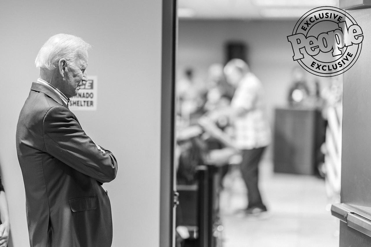 Biden listens as Andy Roberts, business manager of Plumbers and Steamfitters Local 33, introduces him before an Asian and Latino Coalition town hall event in Des Moines, Iowa, on Aug. 8, 2019.