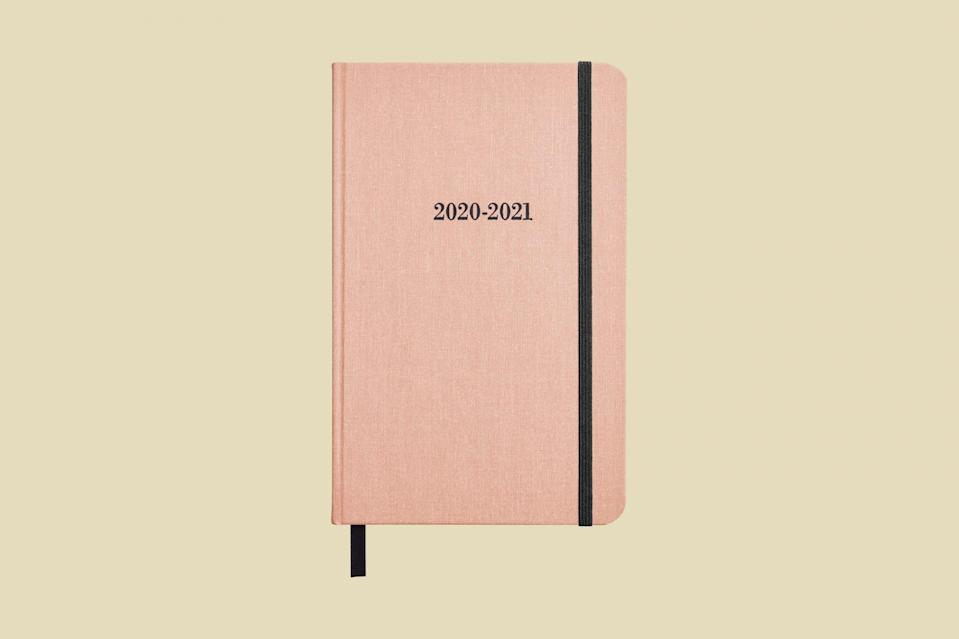 """<p>This blush-colored school planner offers up so much more than just a calendar. Featuring a weekly format on a two-page spread, it also shows your month at a glance, historical facts, moon phases, and there's plenty of room for notetaking.</p> <p><strong><em>Shop Now:</em></strong><em> Shinola Detroit 18-Month """"Runwell"""" Planner, $26, <a href=""""https://www.shinola.com/18month-runwell-planner-2020.html"""" rel=""""nofollow noopener"""" target=""""_blank"""" data-ylk=""""slk:shinola.com"""" class=""""link rapid-noclick-resp"""">shinola.com</a>.</em></p>"""