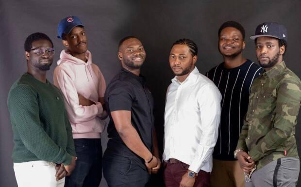 Tomi Okunnuga, second from right, stands with his crew from Orchard Lane Media. Together, they created a series showcasing lesser known eateries in Edmonton. (Tomi Okunnuga/YEG Eats - image credit)