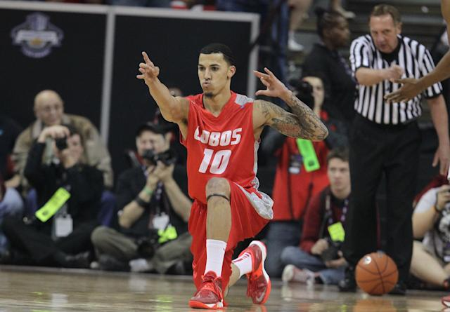 New Mexico's Kendall Williams reacts to a foul during the first half of an NCAA college basketball game against San Diego State for the Mountain West Conference tournament championship on Saturday, March 15, 2014, in Las Vegas. (AP Photo/Isaac Brekken)