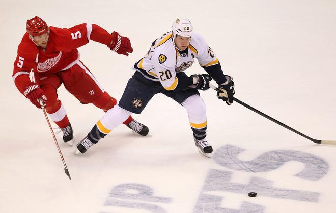 Ryan Suter #20 Of The Nashville Predators Tries To Get Around The Stick Of Nicklas Lidstrom #5 Of The Detroit Red Getty Images