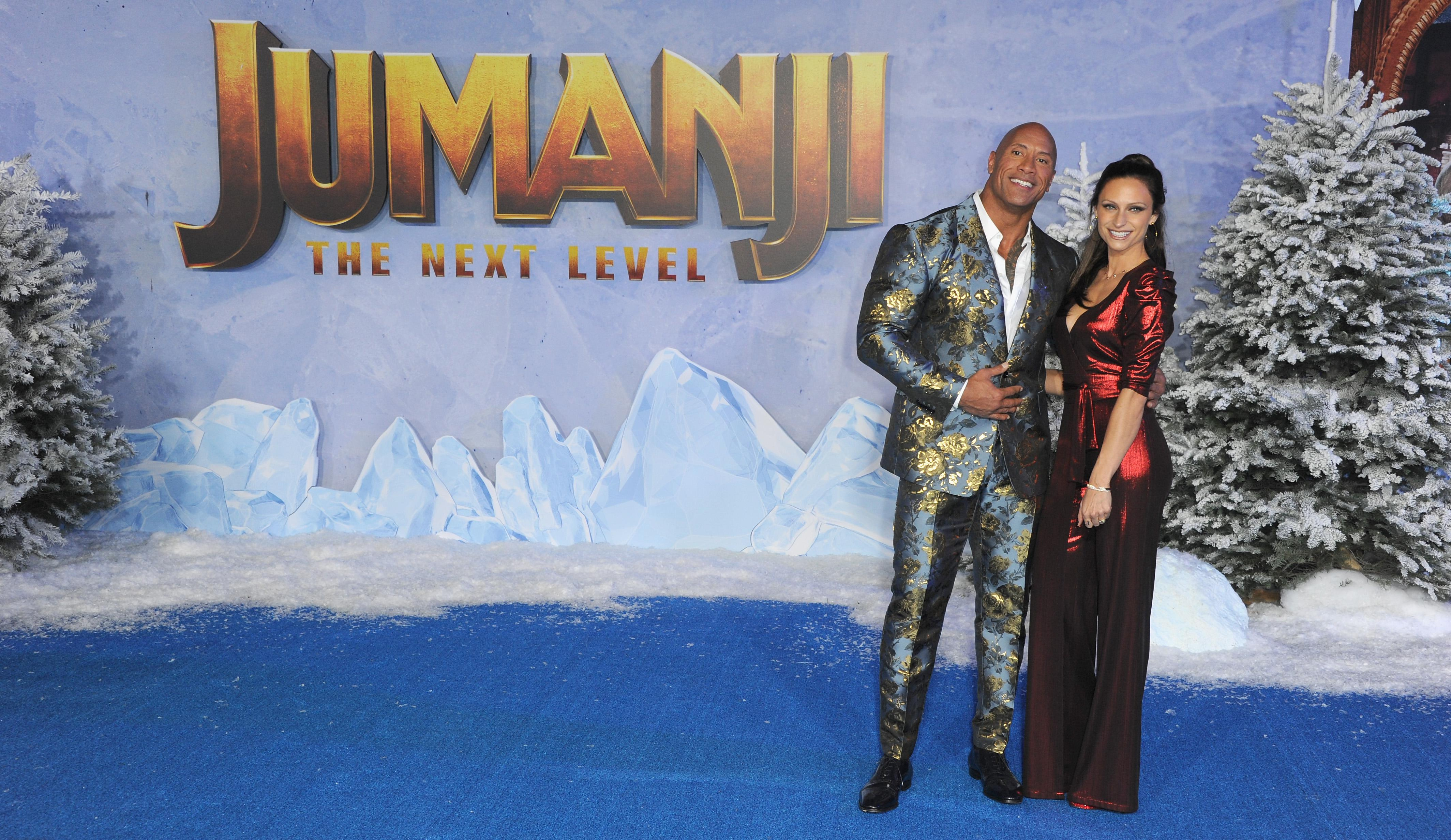 "HOLLYWOOD, CA - DECEMBER 09: Dwayne Johnson and wife Lauren Hashian arrive at the Premiere Of Sony Pictures' ""Jumanji: The Next Level"" held at TCL Chinese Theatre on December 9, 2019 in Hollywood, California. (Photo by Albert L. Ortega/Getty Images)"