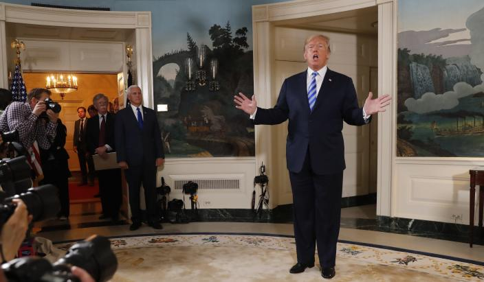 President Trump addresses the media May 8 at the White House after announcing his intention to withdraw from the nuclear agreement with Iran. National security adviser John Bolton and Vice President Mike Pence are in the background. (Photo: Jonathan Ernst/Reuters)
