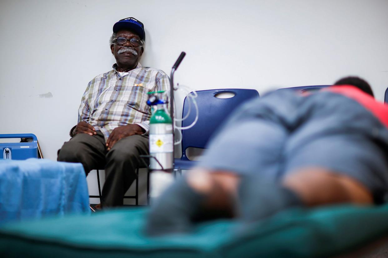 A man using a respiratory machine sits in a shelter run by the Red Cross in Grantsboro, North Carolina, on Sept. 13, 2018. (Photo: Eduardo Munoz / Reuters)