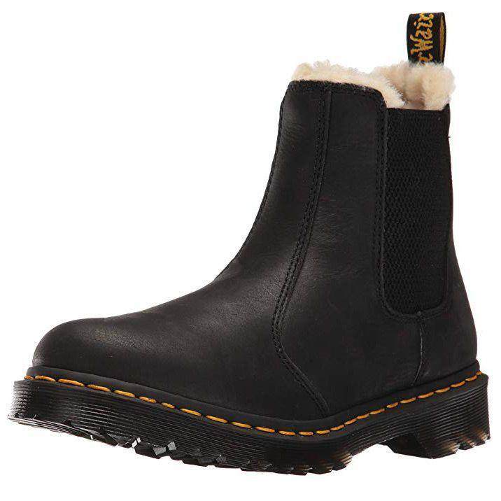 """<p><strong>Dr. Martens </strong></p><p>amazon.com</p><p><a href=""""https://www.amazon.com/dp/B01B271GKM?tag=syn-yahoo-20&ascsubtag=%5Bartid%7C10055.g.29389536%5Bsrc%7Cyahoo-us"""" rel=""""nofollow noopener"""" target=""""_blank"""" data-ylk=""""slk:Shop Now"""" class=""""link rapid-noclick-resp"""">Shop Now</a></p><p>Don't forgo fashion as the temperature drops: these stylish booties feature<strong> waterproofed leather and a rubber sole designed for high traction.</strong> Dr. Martens is known for its high quality boots that last for years to come. The inside of this pair is lined with faux fur for extra warmth. Heads up: reviewers note that these run a bit small.</p>"""