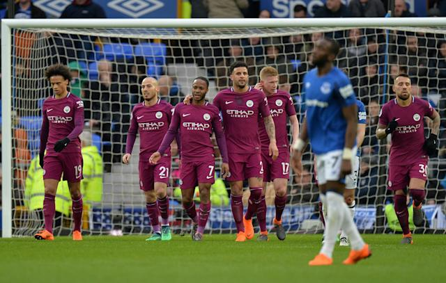 Manchester City players celebrate Raheem Sterling's goal – their third of the first half against Everton. City can win the Premier League title next week. (Reuters)