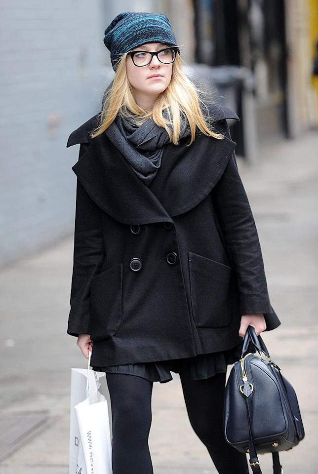 "Dakota Fanning, wearing black-rimmed glasses, looked like just another college co-ed while out in Manhattan, where she attends NYU, in February. She recently talked about her college style, saying: ""If you ever catch me in sweatpants in class, that's not good. I've tried not to dress like that."""