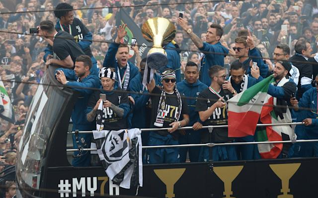 Soccer Football - Serie A - Juventus vs Hellas Verona - Turin, Italy - May 19, 2018 Juventus' Paulo Dybala celebrates winning the league with the trophy and team mates on an open top bus REUTERS/Massimo Pinca