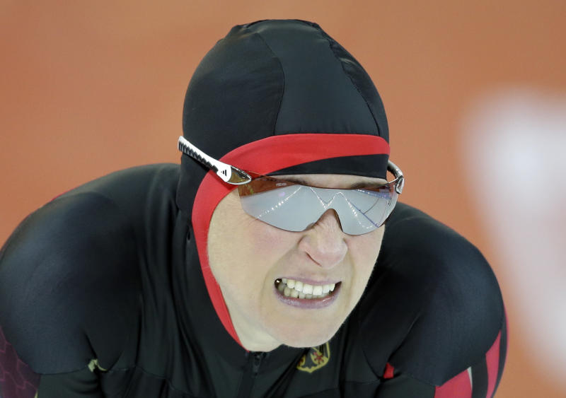 Claudia Pechstein of Germany grimaces after competing in the women's 3,000-meter speedskating race at the Adler Arena Skating Center during the 2014 Winter Olympics, Sunday, Feb. 9, 2014, in Sochi, Russia. (AP Photo/Patrick Semansky)