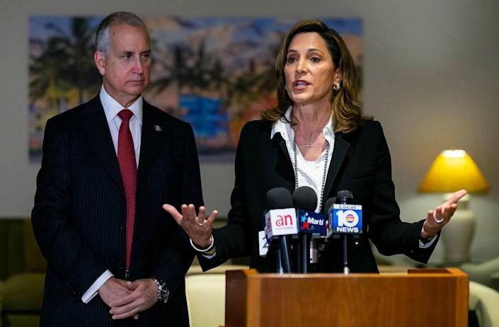 Rep. Maria Elvira Salazar, R-Fla., right, and Rep. Mario Diaz-Balart, R-Fla., hold a press conference about the Cuban Family Reunification Program at the Miami International Airport in Miami, Florida, on Monday, April 19, 2021.