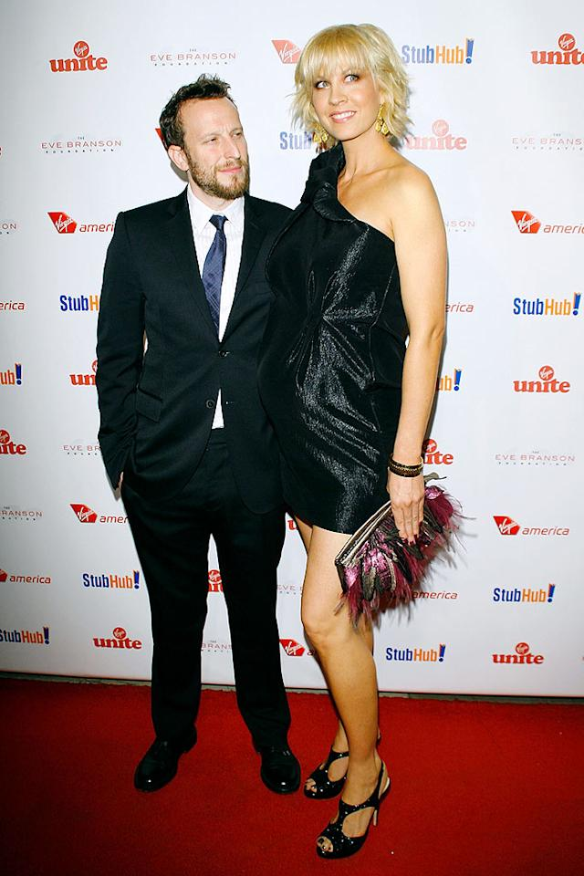 """A pregnant Jenna Elfman towers over husband Bodhi Elfman at the gala, which was held at Vibiana, a converted cathedral built in 1876 in downtown Los Angeles. Michael Tran/<a href=""""http://www.filmmagic.com/"""" target=""""new"""">FilmMagic.com</a> - October 26, 2009"""