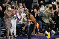 Phoenix Suns forward Mikal Bridges celebrates his three-point basket against the Los Angeles Lakers during the first half of Game 1 of their NBA basketball first-round playoff series Sunday, May 23, 2021, in Phoenix. (AP Photo/Ross D. Franklin)