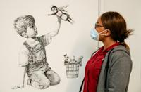 A Banksy work, 'Game Changer', was a tribute to NHS staff during the coronavirus pandemic (AFP/Stuart MARTIN)