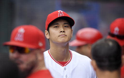Los Angeles Angels starting pitcher Shohei Ohtani, of Japan, walks through the dugout after finishing the first inning of a baseball game against the Tampa Bay Rays, Sunday, May 20, 2018, in Anaheim, Calif. (AP Photo/Mark J. Terrill)