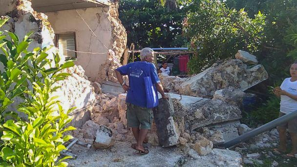 PHOTO: A resident looks at damaged houses after two earthquakes struck in Itbayat town, Batanes islands, northern Philippines, July 27, 2019. (Agnes Salengua Nico/AP)
