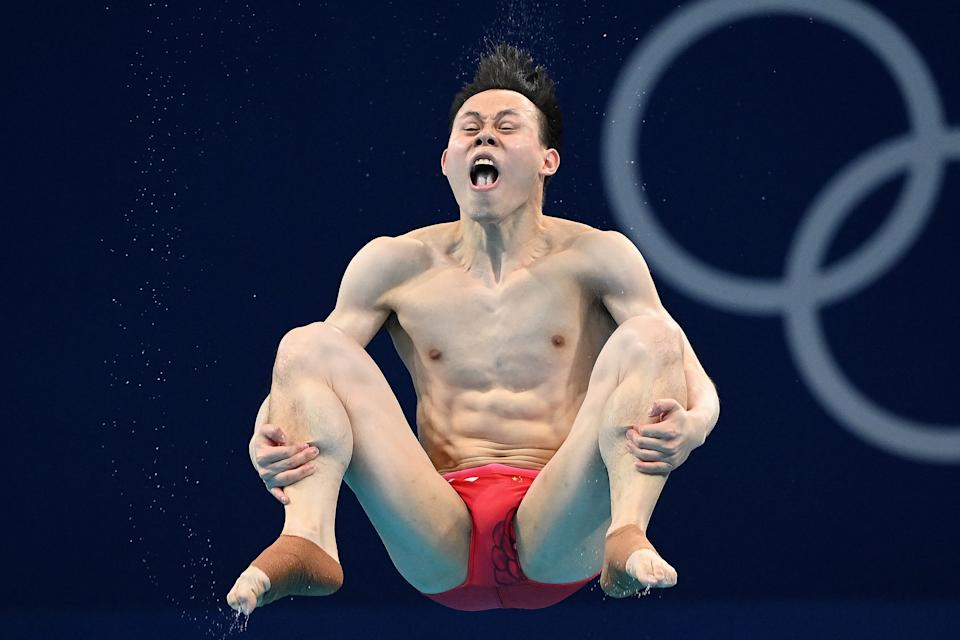 <p>TOPSHOT - China's Xie Siyi competes to win the men's 3m springboard diving final event during the Tokyo 2020 Olympic Games at the Tokyo Aquatics Centre in Tokyo on August 3, 2021. (Photo by Attila KISBENEDEK / AFP) (Photo by ATTILA KISBENEDEK/AFP via Getty Images)</p>