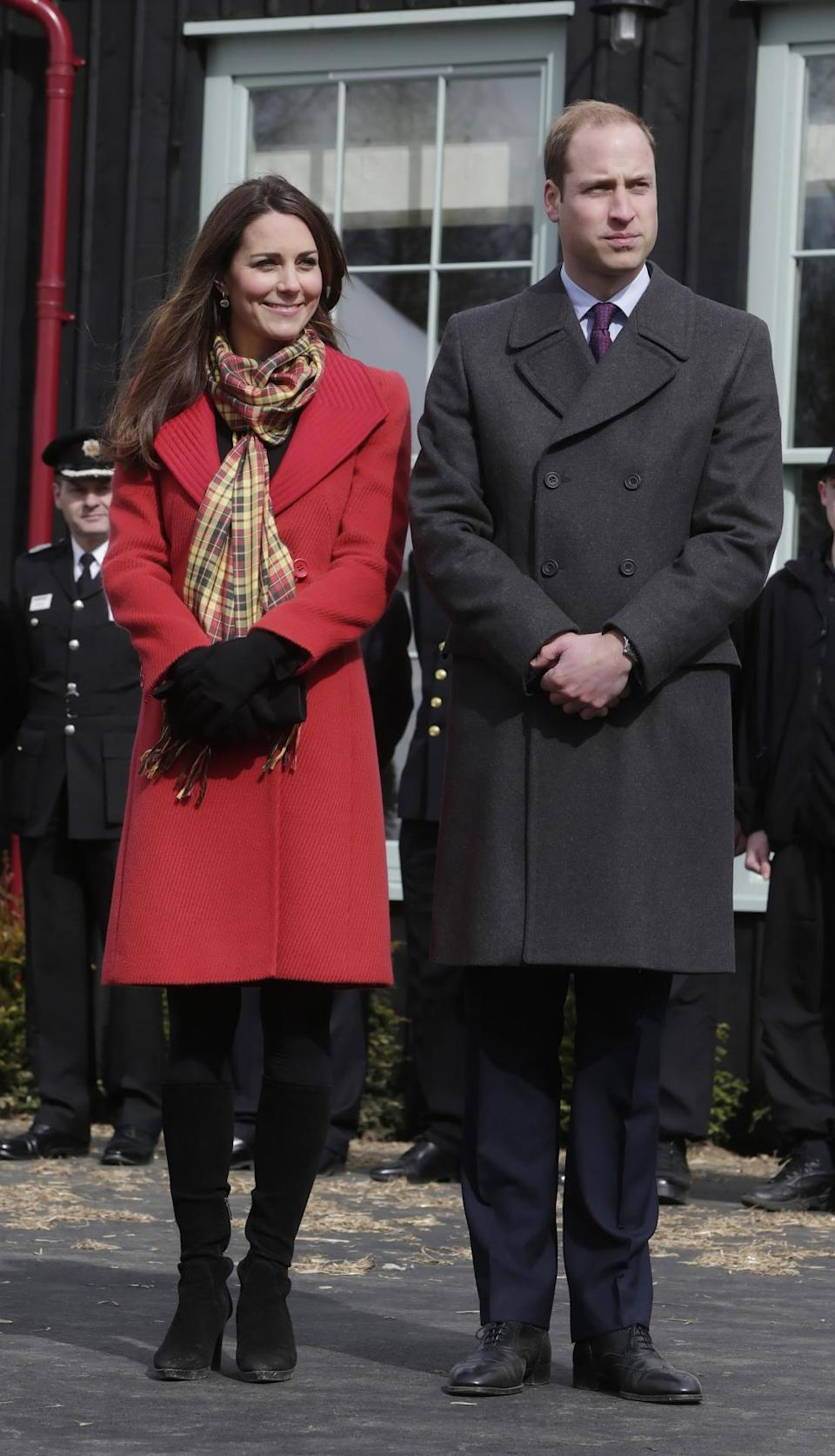 <p>For a day in Scotland, Kate chose a stylish red Armani coat with a tartan scarf and knee high Aquatalia boots. </p><p><i>[Photo: PA]</i></p>