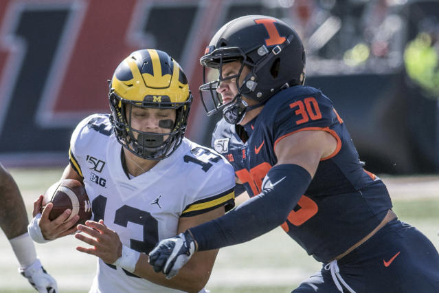 Illinois' Sydney Brown (30) wraps up Michigan's Tru Wilson (13) during the first half of an NCAA college football game, Saturday, Oct. 12, 2019, in Champaign, Ill. (AP Photo/Holly Hart)