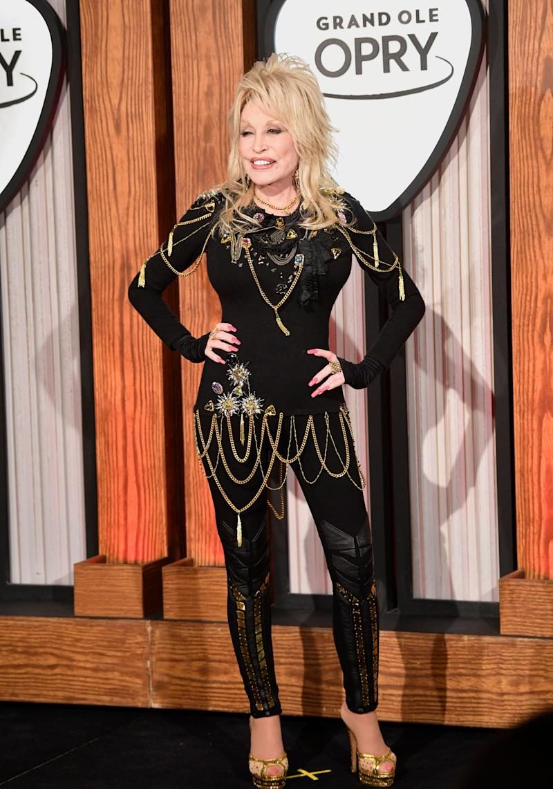 Dolly Parton poses for the camera before a press conference at her 50th Opry Member Anniversary at the Grand Ole Opry on Saturday, Oct. 12, 2019, in Nashville, Tenn.