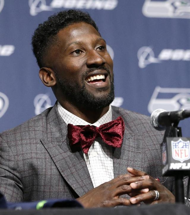Seattle Seahawks' Marcus Trufant smiles during a news conference announcing his retirement from football after signing with the team a day earlier, Thursday, April 24, 2014, in Renton, Wash. Trufant started 125 games in a Seattle career that lasted from 2003 to 2012. The cornerback was a first-round pick in 2003 out of Washington State and immediately moved into the starting lineup, playing a key role on the 2005 team that advanced to the franchise's first Super Bowl. (AP Photo/Elaine Thompson)