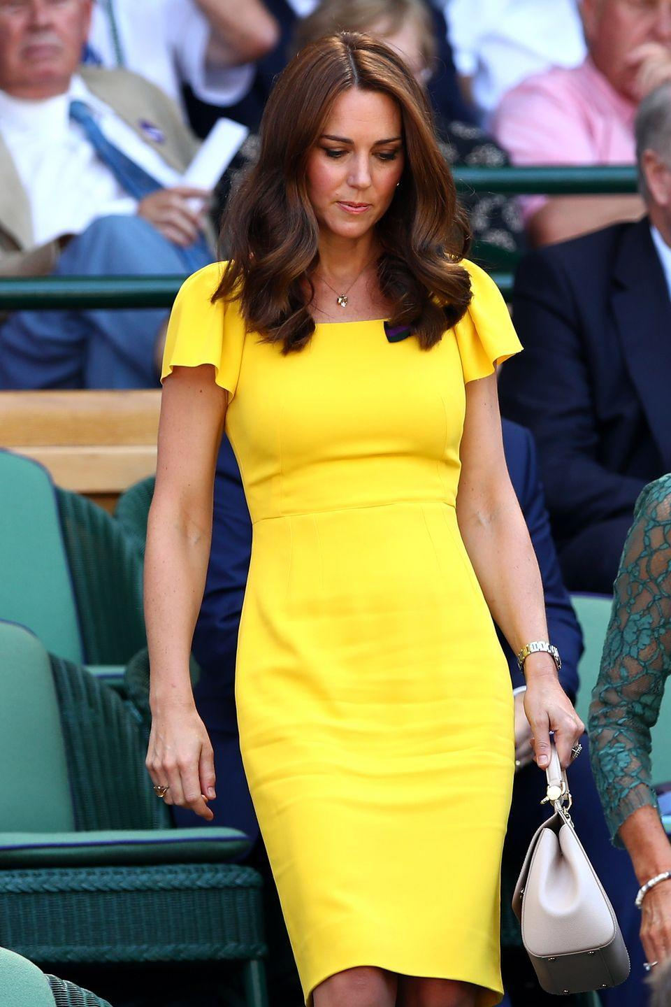 <p><strong>2018</strong> The Duchess of Cambridge made a sunny appearance in a bright yellow Dolce & Gabbana dress.</p>