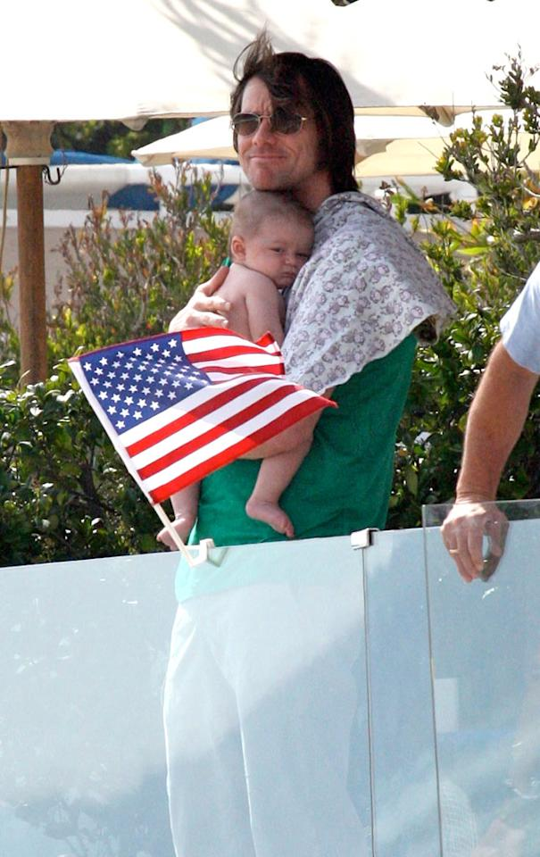 """Goofy Jim Carrey showed his sensitive side while cuddling up to his grandson, Jackson, the 4-month-old son of his daughter Jane, in Malibu. Mike/<a href=""""http://www.splashnewsonline.com"""" target=""""new"""">Splash News</a> - July 4, 2010"""