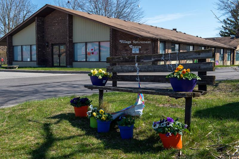 Flowers sit on a bench in front of Orchard Villa care home in Pickering, Ont., on April 27, 2020. This facility is one of five mentioned in a new report on long-term care homes in Ontario. (Photo: FRANK GUNN/THE CANADIAN PRESS)