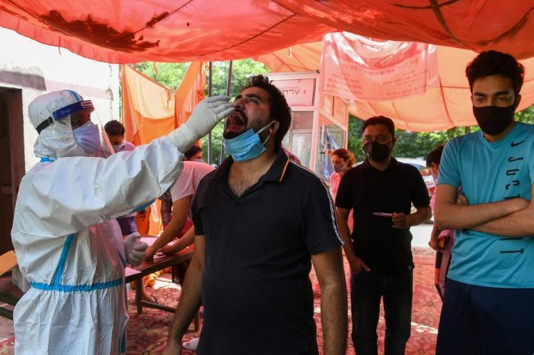 A man is tested for coronavirus in Ghaziabad, India
