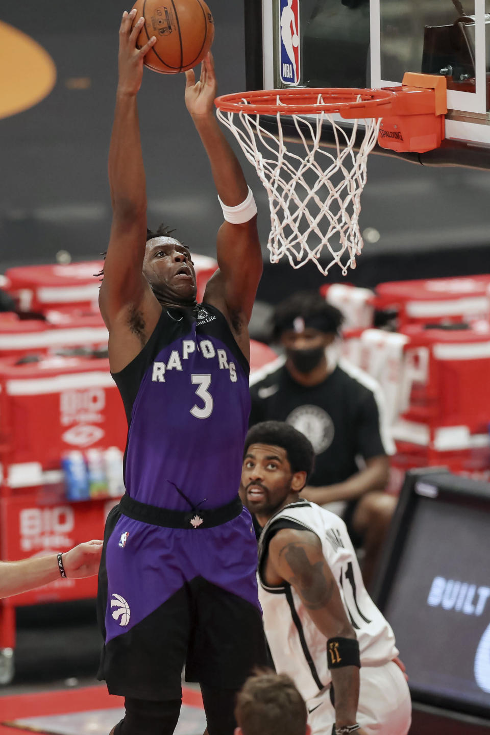 Toronto Raptors' OG Anunoby dunks past Brooklyn Nets' Kyrie Irving during the second half of an NBA basketball game Wednesday, April 21, 2021, in Tampa, Fla. (AP Photo/Mike Carlson)