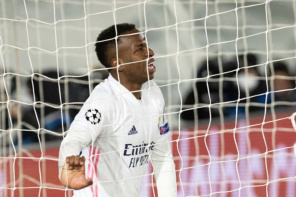 MADRID, SPAIN - MARCH 16: (BILD ZEITUNG OUT) Vinicius Junior of Real Madrid looks on during the UEFA Champions League Round of 16 match between Real Madrid and Atalanta at Estadio Santiago Bernabeu on March 16, 2021 in Madrid, Spain. Sporting stadiums around Spain remain under strict restrictions due to the Coronavirus Pandemic as Government social distancing laws prohibit fans inside venues resulting in games being played behind closed doors. (Photo by DeFodi Images via Getty Images)