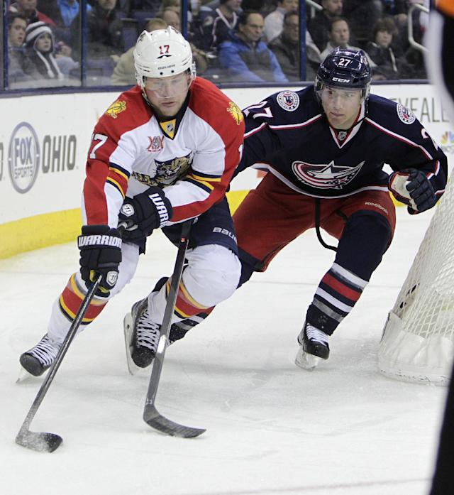 Florida Panthers' Shawn Matthias, right, and Columbus Blue Jackets' Jack Johnson chase a loose puck during the third period of an NHL hockey game Saturday, March 1, 2014, in Columbus, Ohio. The Blue Jackets defeated the Panthers 6-3. (AP Photo/Jay LaPrete)
