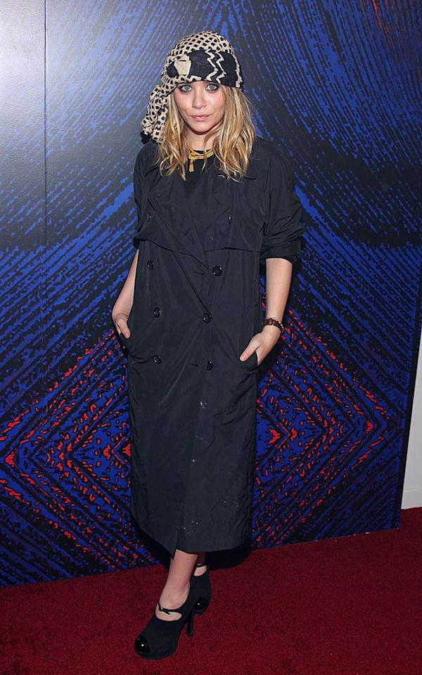 """Eclectic as usual, Ashley Olsen donned a shapeless trench and a printed headscarf for the YSL Belle D'Opium fragrance launch in New York City Thursday night. Mike Coppola/<a href=""""http://www.wireimage.com"""" target=""""new"""">WireImage.com</a> - June 17, 2010"""