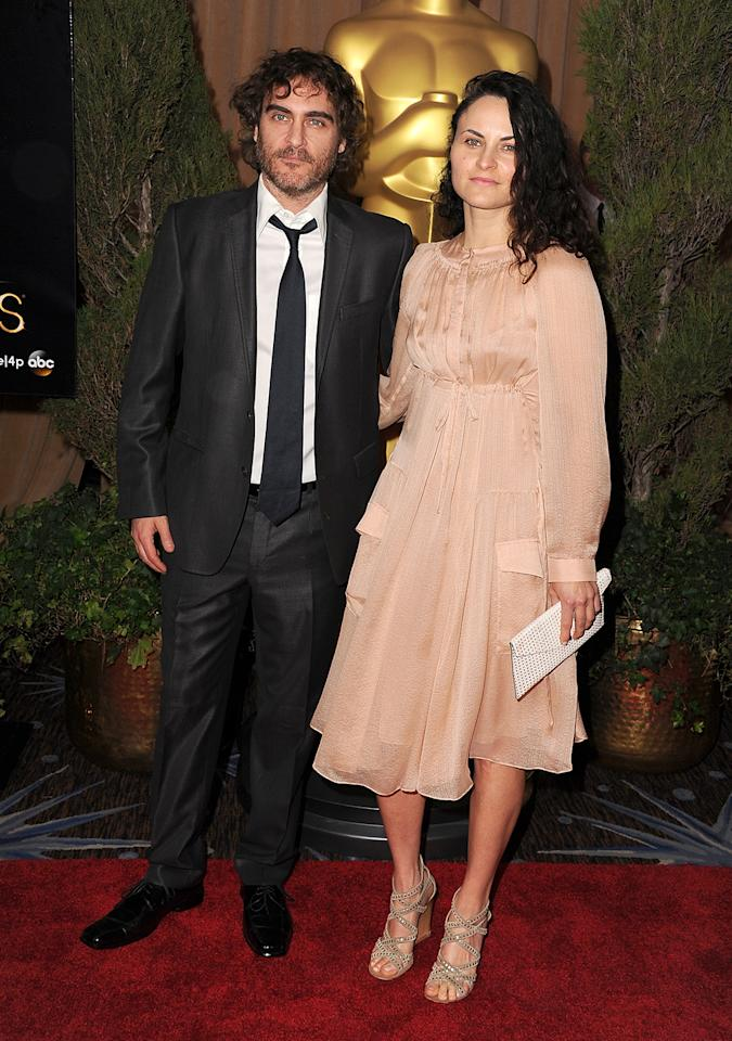 Joaquin Phoenix (L) and Rain Phoenix attend the 85th Academy Awards Nominees Luncheon at The Beverly Hilton Hotel on February 4, 2013 in Beverly Hills, California.  (Photo by Steve Granitz/WireImage)