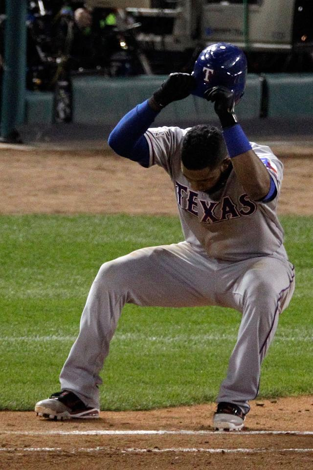 ST LOUIS, MO - OCTOBER 28:  Elvis Andrus #1 of the Texas Rangers reacts after flying out to end the top of the seventh inning during Game Seven of the MLB World Series against the St. Louis Cardinals at Busch Stadium on October 28, 2011 in St Louis, Missouri.  (Photo by Rob Carr/Getty Images)