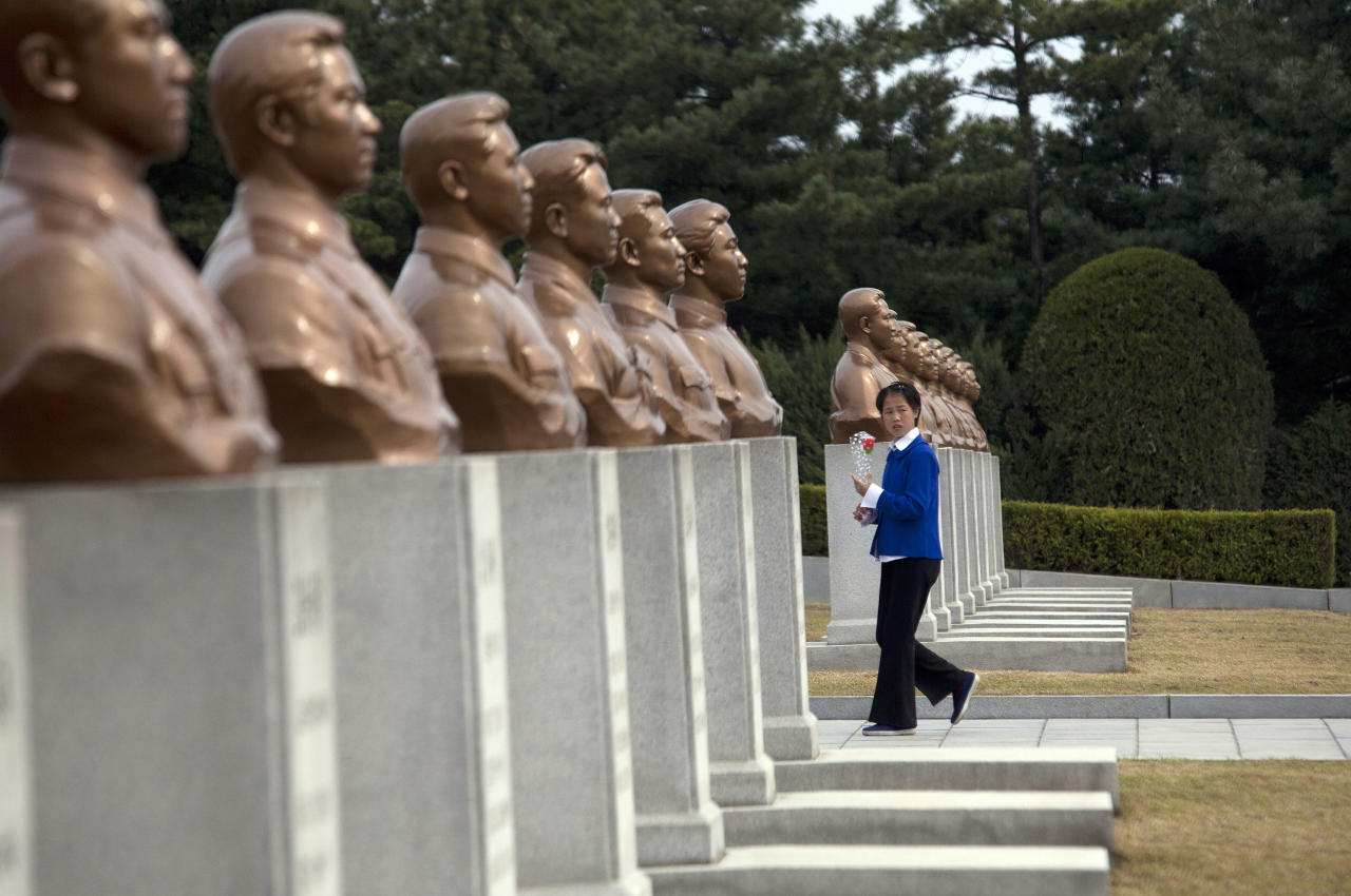 In this April 21, 2011 photo, a girl carries a flower through a memorial cemetery in Pyongyang, North Korea, for men and women who died fighting against the Japanese occupation. (AP Photo/David Guttenfelder)