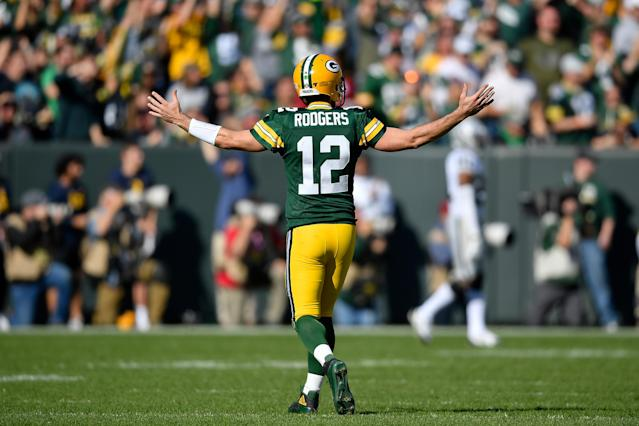 Aaron Rodgers of the Green Bay Packers reacts after throwing a touchdown against the Raiders. (Getty Images)