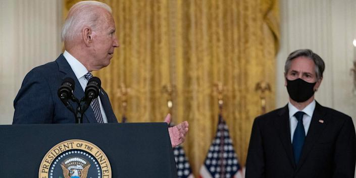 US President Joe Biden, with Secretary of State Antony Blinken (R), speaks about the ongoing US military evacuations of US citizens and vulnerable Afghans, in the East Room of the White House in Washington, DC, on August 20, 2021.
