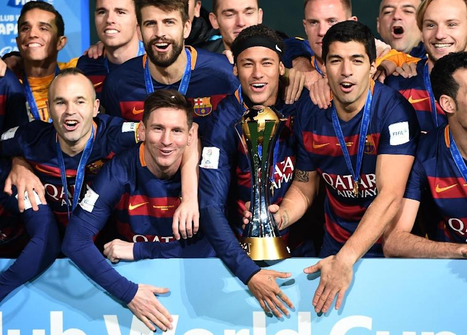 Barcelona's players celebrate around the FIFA Club World Cup trophy after defeating River Plate 3-0 in the tournament final, in Yokohama, suburban Tokyo, on December 20, 2015 (AFP Photo/Toshifumi Kitamura)