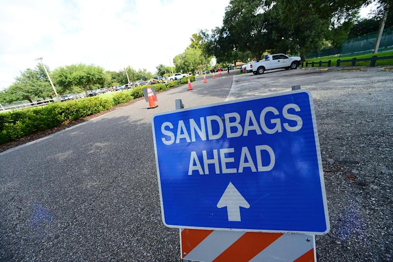 A sign announces for free sandbags distributed by the Seminole County government to its residents before the hurricane Dorian hits Florida in the upcoming days on Aug. 29, 2019 in Casselberry, Florida. (Photo by Gerardo Mora/Getty Images)