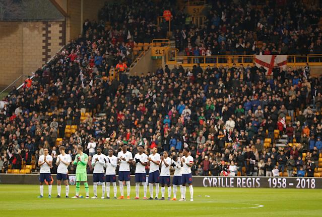 Soccer Football - Under 21 International Friendly - England vs Romania - Molineux Stadium, Wolverhampton, Britain - March 24, 2018 England players line up during a minute's applause in memory of Cyrille Regis Action Images via Reuters/Andrew Boyers
