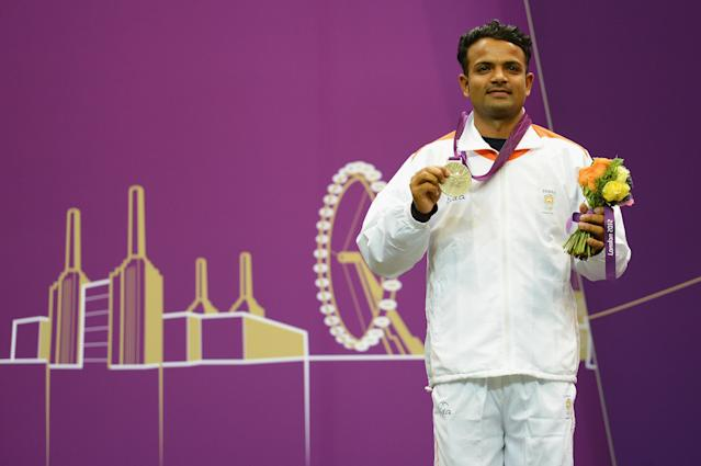 LONDON, ENGLAND - AUGUST 03: Silver medallist Vijay Kumar of India celebrates with his silver medal during the medal ceremony following the Men's 50m Rifle Prone Shooting final on Day 7 of the London 2012 Olympic Games at The Royal Artillery Barracks on August 3, 2012 in London, England. (Photo by Lars Baron/Getty Images)