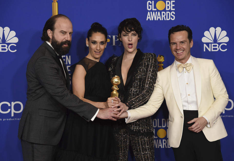 "Brett Gelman, from left, Sian Clifford, Phoebe Waller-Bridge and Andrew Scott, from the cast of ""Fleabag,"" pose in the press room with the award for best television series, musical or comedy, at the 77th annual Golden Globe Awards at the Beverly Hilton Hotel on Sunday, Jan. 5, 2020, in Beverly Hills, Calif. (AP Photo/Chris Pizzello)"