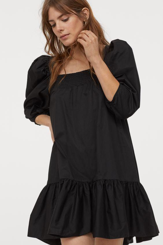 """<p>If you can't part with your black dresses even in the summertime, this <a href=""""https://www.popsugar.com/buy/HampM-Puff-Sleeved-Cotton-Dress-562852?p_name=H%26amp%3BM%20Puff-Sleeved%20Cotton%20Dress&retailer=www2.hm.com&pid=562852&price=15&evar1=fab%3Aus&evar9=47559591&evar98=https%3A%2F%2Fwww.popsugar.com%2Fphoto-gallery%2F47559591%2Fimage%2F47559715%2FHM-Puff-Sleeved-Cotton-Dress&list1=shopping%2Ch%26m%2Cdresses%2Csustainability%2Cproducts%20under%20%2450%2Cfashion%20shopping%2Csustainable%20fashion&prop13=api&pdata=1"""" rel=""""nofollow"""" data-shoppable-link=""""1"""" target=""""_blank"""" class=""""ga-track"""" data-ga-category=""""Related"""" data-ga-label=""""https://www2.hm.com/en_us/productpage.0857571001.html"""" data-ga-action=""""In-Line Links"""">H&amp;M Puff-Sleeved Cotton Dress</a> ($15) is a great option.</p>"""